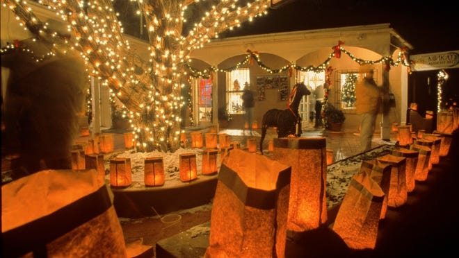 Santa Fe, New Mexico's saintly city, glows with lights and luminarias come Christmas Eve.