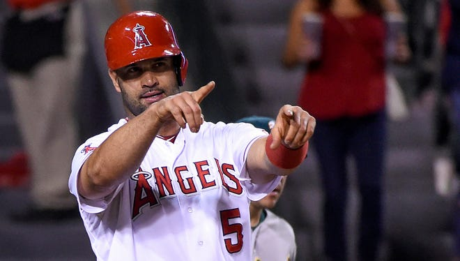 Angels first baseman Albert Pujols reacts after scoring a run during the fifth inning at Angel Stadium of Anaheim.