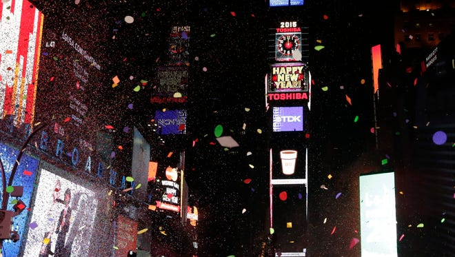 The 2015 New Year's Eve celebrations at New York's Times Square didn't spread to Wall Street. (EPA/JASON SZENES)