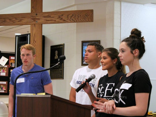 Marrisa Kegelman, with microphone, and left to right, Casey Rock, Austin Figliola and Lauren Desmond, announce the St. Elizabeth Class of 2018 Senior Gift.