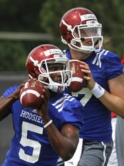 Tre Roberson (front), shown here during IU practice in 2013, split quarterback duties with Nate Sudfeld the year before he decided to transfer.