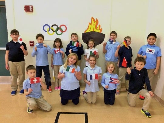 St. Gabriel Elementary School, Neenah, students learned about Olympic history, the symbolism of the flag, and some of the events during physical education class. The students competed in their own version of luge, skeleton, bobsledding (two- and four-person), a biathlon and ski jumping.