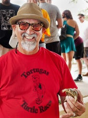 Ron Nestle holds the 2016 Tortugas Turtle Race champion.