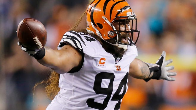 Cincinnati Bengals defensive tackle Domata Peko (94) celebrates a fumble recovery in the second quarter of the NFL Week 4 game between the Cincinnati Bengals and the Miami Dolphins at Paul Brown Stadium on Thursday, Sept. 29, 2016. At halftime the Bengals led 16-7.