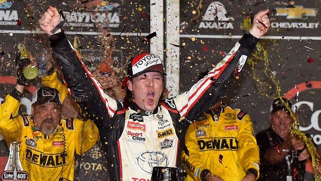 Erik Jones celebrates after winning the Coke Zero Sugar 400, Saturday night at Daytona International Speedway.