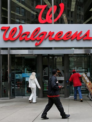 This file photo taken in June 2014 shows a Walgreens store in Boston, Mass.