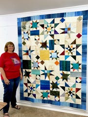 "Audrey Bee and her queen-sized quilt ""Ocean Stars"" will be one of 136 quilts on display when the Red River Quilters Guild has their Quilting in the Falls exhibit from 9 a.m. to 6 p.m. today and Saturday at the Ray Clymer Exhibit Hall. Bee is the chair of the program."