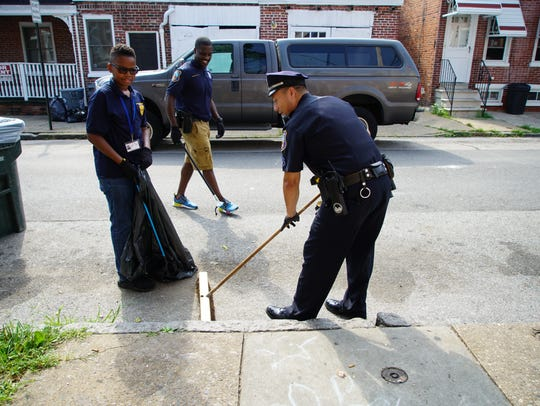 Officers with the Wilmington police cleanup the streets