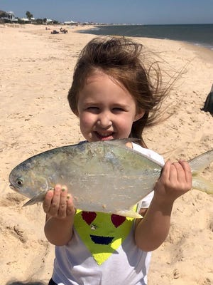Little Ella Donahoe with a pompano caught off St. George Island beach. She was fishing with her father, Capt. Nathan Donahoe.