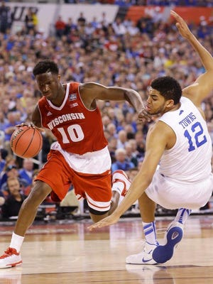 Nigel Hayes drives past Karl-Anthony Towns during Wisconsin's 71-64 win Saturday over Kentucky in the NCAA Final Four.