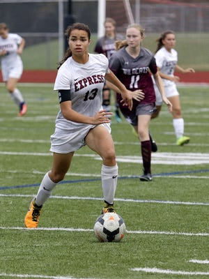 Elmira's Kendra Oldroyd looks for room Sept. 14 during the Express' 9-0 win over Johnson City at Ernie Davis Academy.