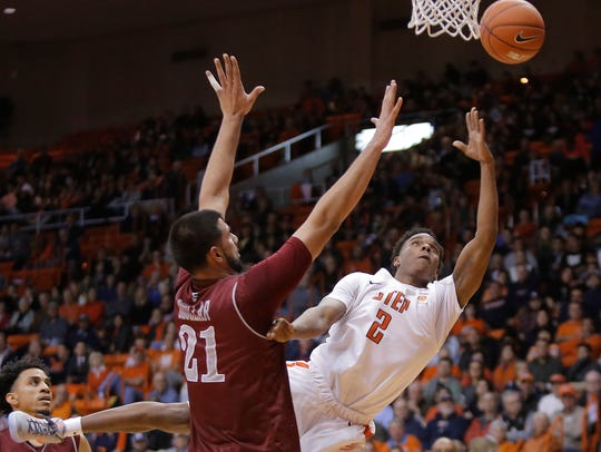 UTEP guard Omega Harris lays up a shot over NMSU center