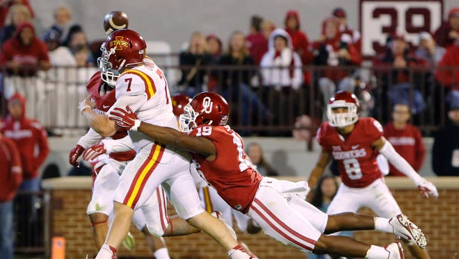 Oklahoma linebacker Eric Striker (19) tackles Iowa State quarterback Joel Lanning (7) as he passes the ball during the fourth quarter of an NCAA college football game in Norman, Okla., on Saturday, Nov. 7, 2015. Oklahoma won 52-16.