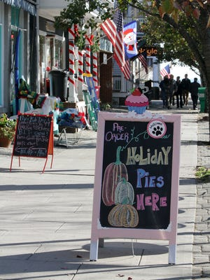 Business owners create holiday signs and displays on Main Avenue in preparation for the holidays and Small Business Saturday in Ocean Grove.