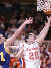 Union County's Michael Sustarsic executes a layup against Lincoln's Brett Singer during a Class 2A sectional game Friday, Feb. 29, 2008 at Hagerstown.