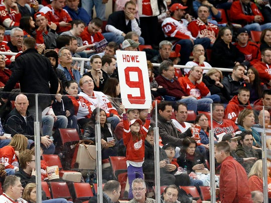 A Detroit Red Wings fan holds up a sign for Gordie Howe at Joe Louis Arena.