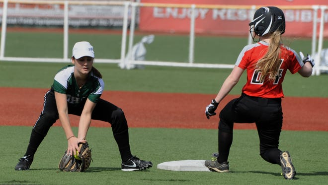 Ohio University-Chillicothe's Kendra Barnes scoops up the ball at second base during their game against University of Cincinnati-Clermont on Friday at VA Memorial Stadium.