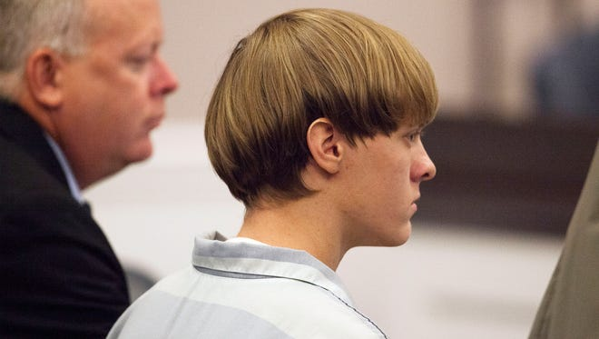 Dylann Roof appears at a court hearing in Charleston, S.C., on Thursday, July 16, 2015. A judge ruled Thursday that Roof, accused of killing nine people at the Emanuel AME Church in Charleston in June, will stand trial in July, 2016.   (Randall Hill, Pool Photo via AP)