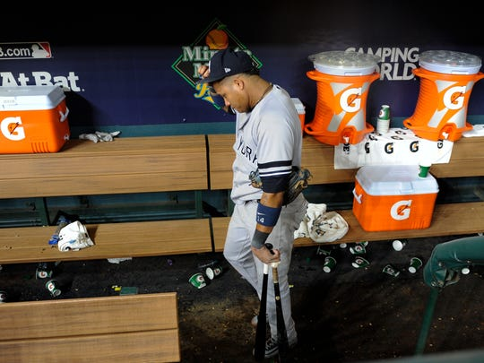 New York Yankees' Starlin Castro walks to the clubhouse