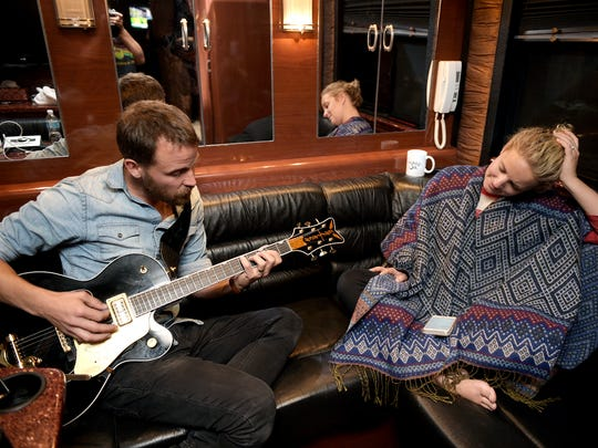 Anders Mouridsen,left,  and Cam work together on writing a song in the back of the tour bus after a concert stop at Red Rocks Amphitheatre in Morrison, Colo. on Wednesday, Aug. 10, 2016.  Mouridsen plays guitars, banjo, vocals, co-writer from Cam's band.