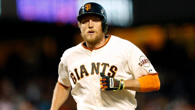 Giants right fielder Hunter Pence rounds the bases after hitting a solo home run against the Athletics at AT&T Park.
