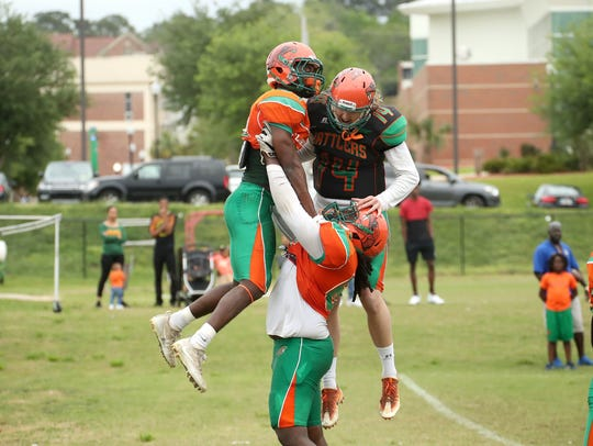 FAMU players celebrate Chad Hunter's second touchdown