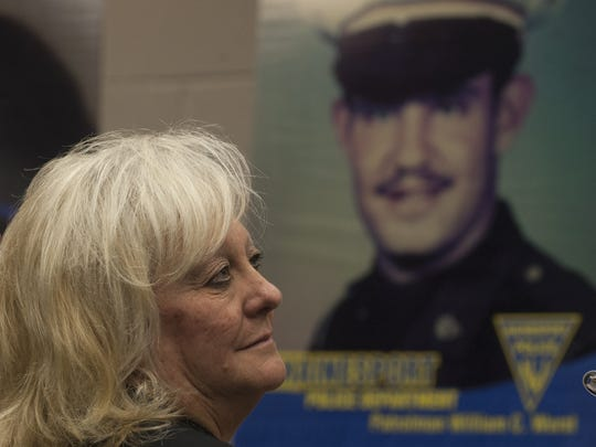 Family member of fallen Officer William Wurst,  Cheryl Wurst, looks on during an annual tribute to three fallen officers. Two Mount Holly officers and one from Hainesport were ambushed in the street in 1975 by a sniper. Officers Donald Aleshire of Mount Holly and William Wurst of Hainesport were killed. John Holmes of Mount Holly also was shot and died years later of his serious wounds.
