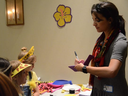 Ana Villafañe signs autographs for little kids at the