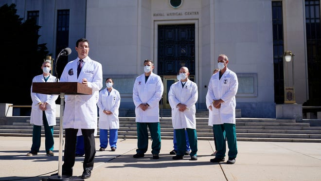 President Donald Trump's doctors speak outside Walter Reed Medical Center on Saturday.