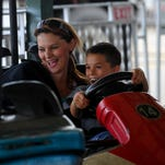 Jessica McFall rides the bumper cars with her son Braden DeBoo, 7, on Tuesday at the Montana State Fair.
