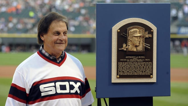 Former Chicago White Sox manager Tony La Russa stands with his Major League Baseball Hall of Fame plaque before the second game of a doubleheader against the Detroit Tigers in Chicago on Saturday, Aug.  30, 2014.