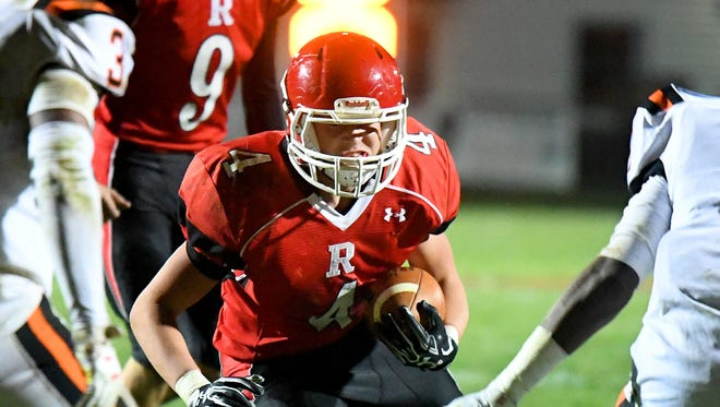 Blake Smith, center, a two-way standout for Riverheads' football team this season, was named All-Region 1B Defensive Player of the Year by the region's head coaches..