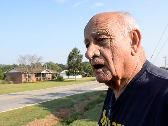 Waymon White of Starr looks toward Flat Rock Road in front of his home, where George Eugene Williams, 73, of Iva was struck by a passing car and killed Monday.  Williams' car broke down on Flat Rock Road in Starr, according to Anderson County Deputy Coroner Charlie Boseman.