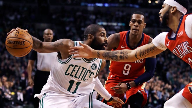 Boston Celtics guard Kyrie Irving (11) may be a talented basketball player, but would you buy his Flat Earth Theory?