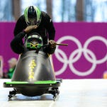 Feb 13, 2014; Krasnaya Polyana, RUSSIA; Jamaica two-man bobsled team piloted by Winston Watts (JAM) on a training run during the Sochi 2014 Olympic Winter Games at Sanki Sliding Center. Mandatory Credit: John David Mercer-USA TODAY Sports