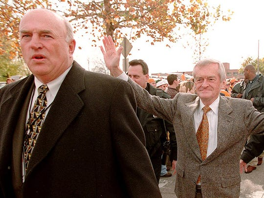 "Bill Anderson (left) and John Ward take part in the team ""Vol Walk"" in 1998  after being persuaded by football players that they considered them part of the team and he should walk with them on the last home game."