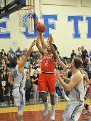 Galion's Zhamir Anderson puts up a layup with a trio
