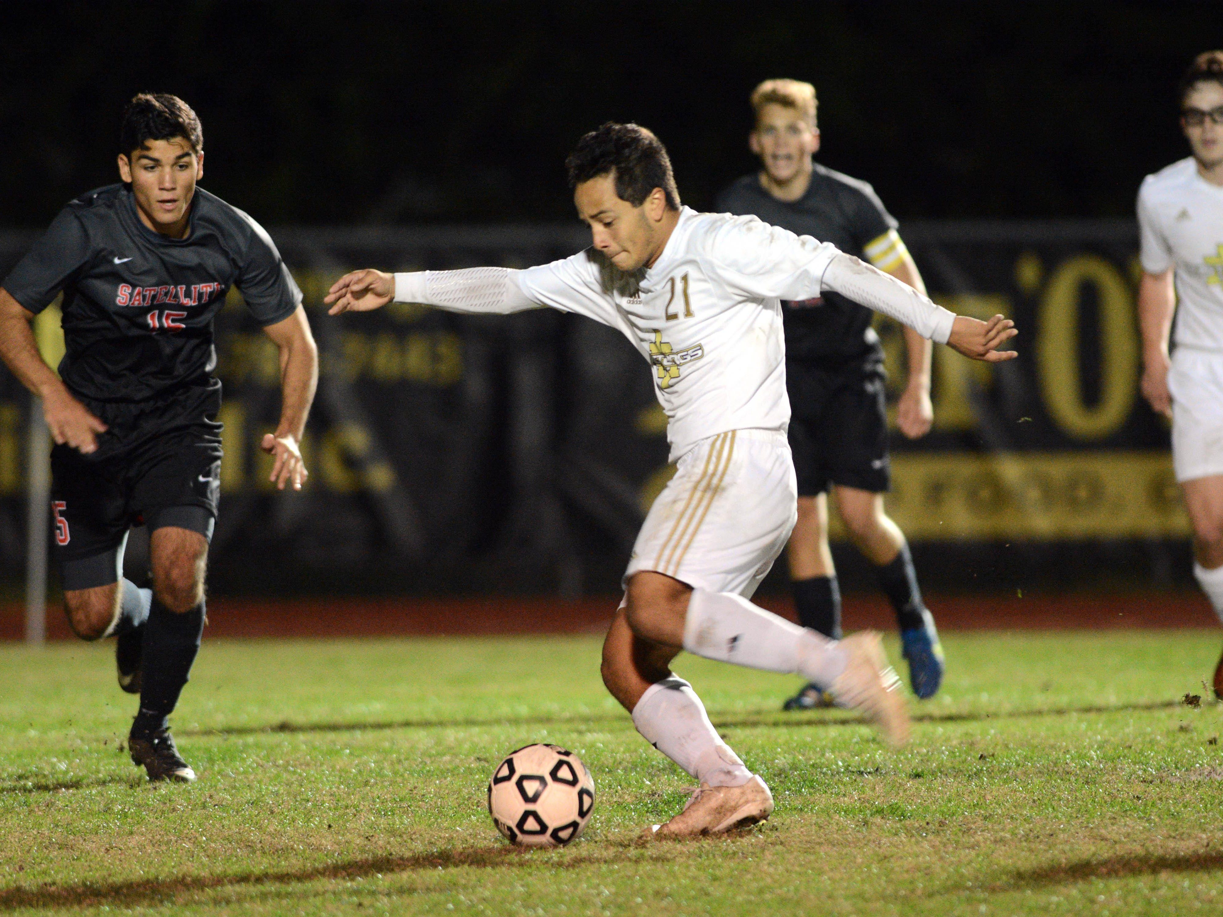 Merritt Island's Cameron Michaels taks a shot on goal during Friday's District 12 Class 3A championship against Satellite.