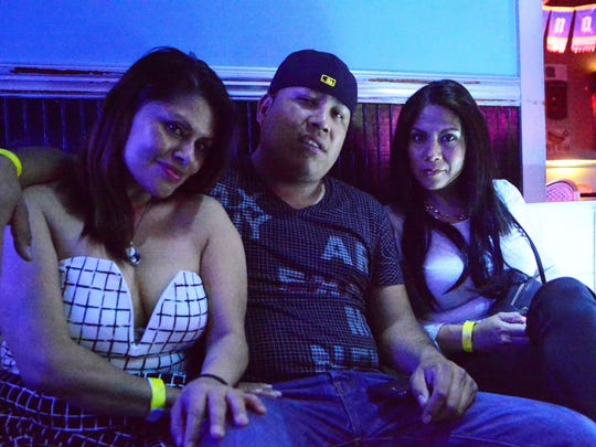 Cascada in Asbury Park features Latin music several nights a week and is contributing to the growing Latin music scene at the Jersey Shore. Shown are clubgoers Elva Mtz (left), Reyes Rojas and Patricia Torres, all of Asbury Park.