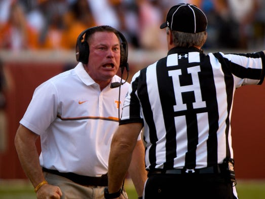 Tennessee head coach Butch Jones exchanges words with