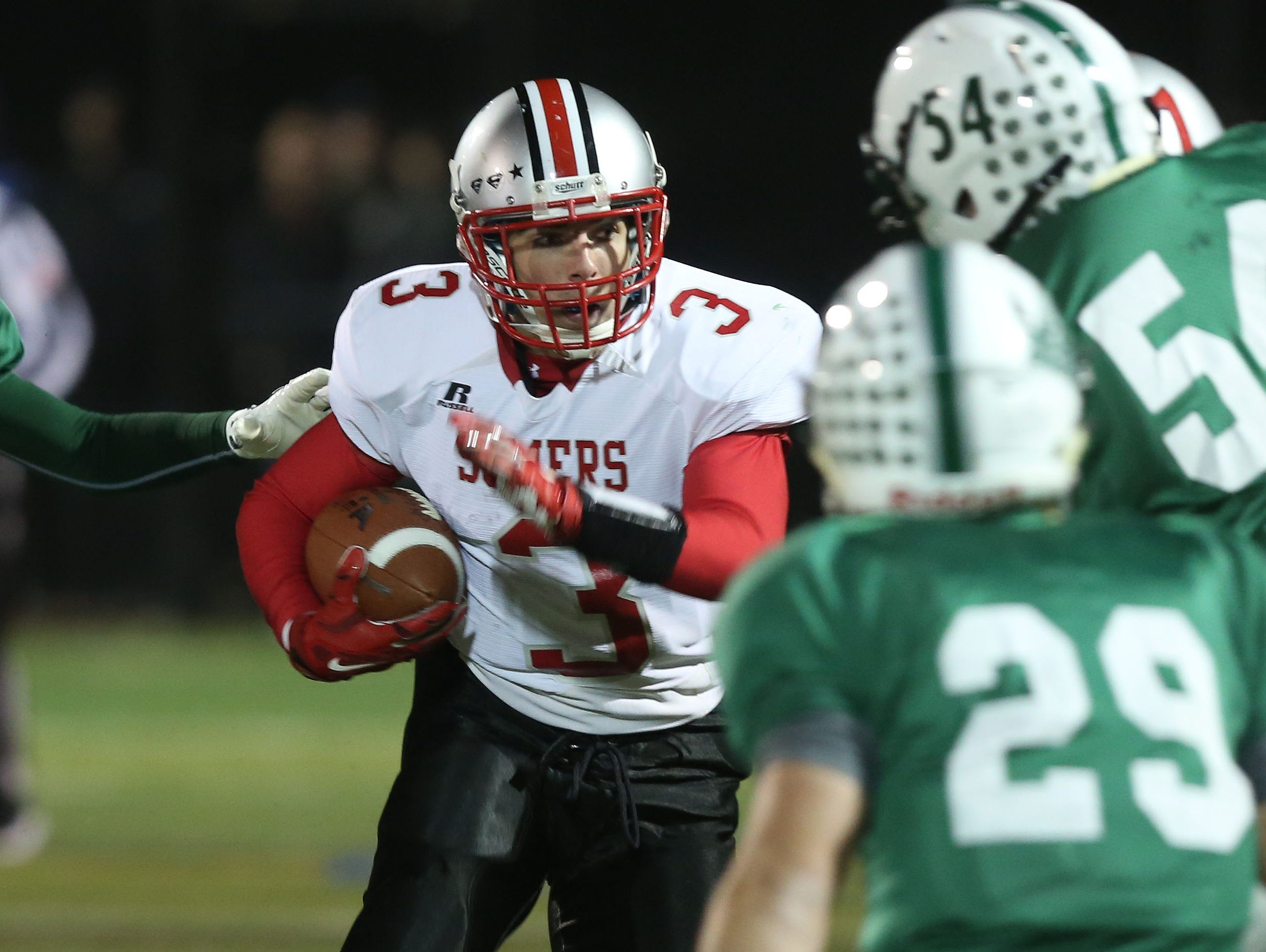 Somers' Matthew Pires (3) looks for some running in the Brewster defense during the Section 1 Class A semifinals at Brewster High School Oct. 28, 2016.