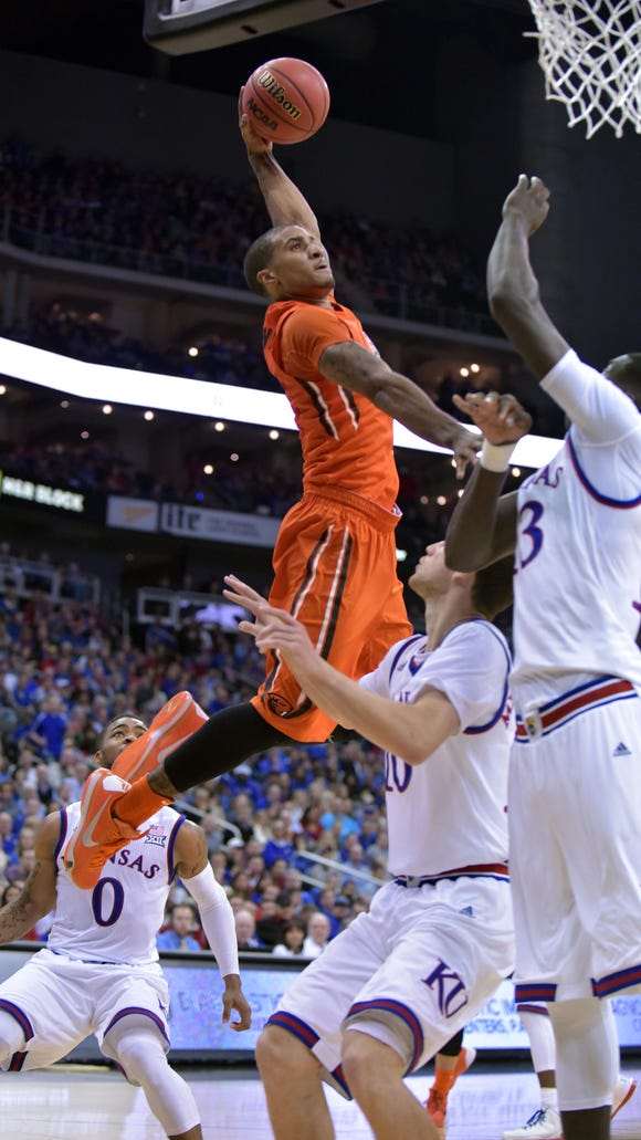 Dec 12, 2015; Kansas City, MO, USA; Oregon State Beavers guard Gary Payton II (1) dunks the ball over Kansas Jayhawks forward Cheick Diallo (13) during the first half at Sprint Center. Mandatory Credit: Denny Medley-USA TODAY Sports
