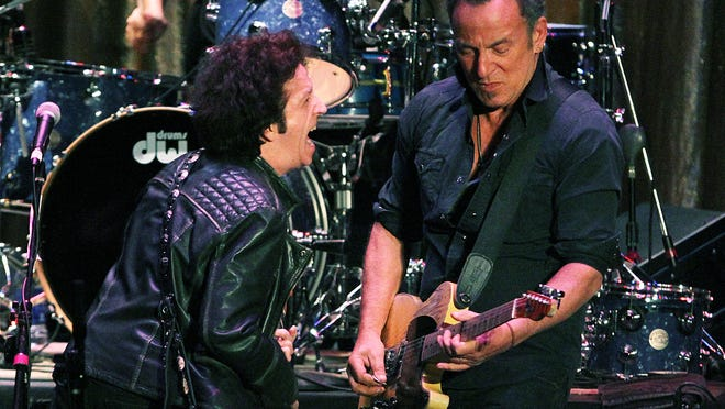 Bruce Springsteen joins Willie Nile on stage at the Paramount during the 15th annual Light of Day benefit show.
