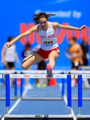 Caroline Schaeckenbach of Iowa City City High runs the girls 400 meter hurdles relay at the Drake Relays Saturday, April 28, 2018.