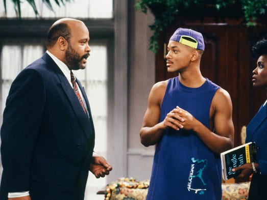 """This photo provided by NBC shows, from left, James Avery as Philip Banks, Will Smith as William """"Will"""" Smith, and Janet Hubert as Vivian Banks, in episode 7, """"Def Poet's Society"""" from the TV series, """"The Fresh Prince of Bel-Air."""" Avery, 65, the bulky character actor who laid down the law as the Honorable Philip Banks has died. Avery's publicist, Cynthia Snyder, told The Associated Press that Avery died Tuesday, Dec. 31, 2013."""
