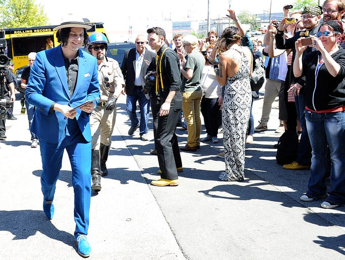 """Jack White delivers the first batch of the """"World's Fastest Record"""" to fans in front of Third Man Records Saturday, April 19, 2014 in Nashville, Tenn. White and his band recorded the record live Saturday morning and had records pressed within hours on Record Store Day."""