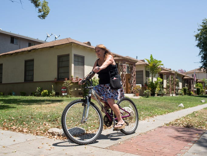 Dorothy Edwards rides her bike to a nearby grocery store. For eight years, Edwards, 56, wandered the streets of Pasadena sleeping in alleys, scouring dumpsters for scraps of food and smoking meth to fend off a crushing depression.