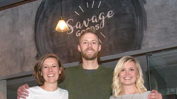Tyler Savage, his wife Michelle, right, and his sister,