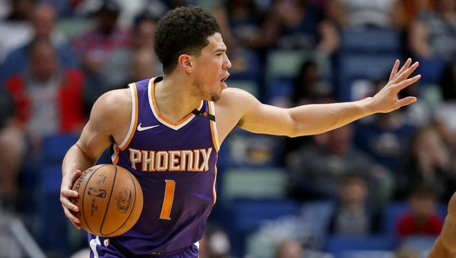 Feb 26, 2018; New Orleans, LA, USA; Phoenix Suns guard Devin Booker (1) gestures in the second quarter against the New Orleans Pelicans at the Smoothie King Center. Mandatory Credit: Chuck Cook-USA TODAY Sports