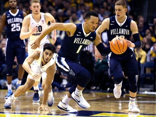Villanova's Jalen Brunson steals the ball as Marquette's Markus Howard looks on during the second half of an NCAA college basketball game Sunday, Jan. 28, 2018, in Milwaukee. (AP Photo/Tom Lynn)